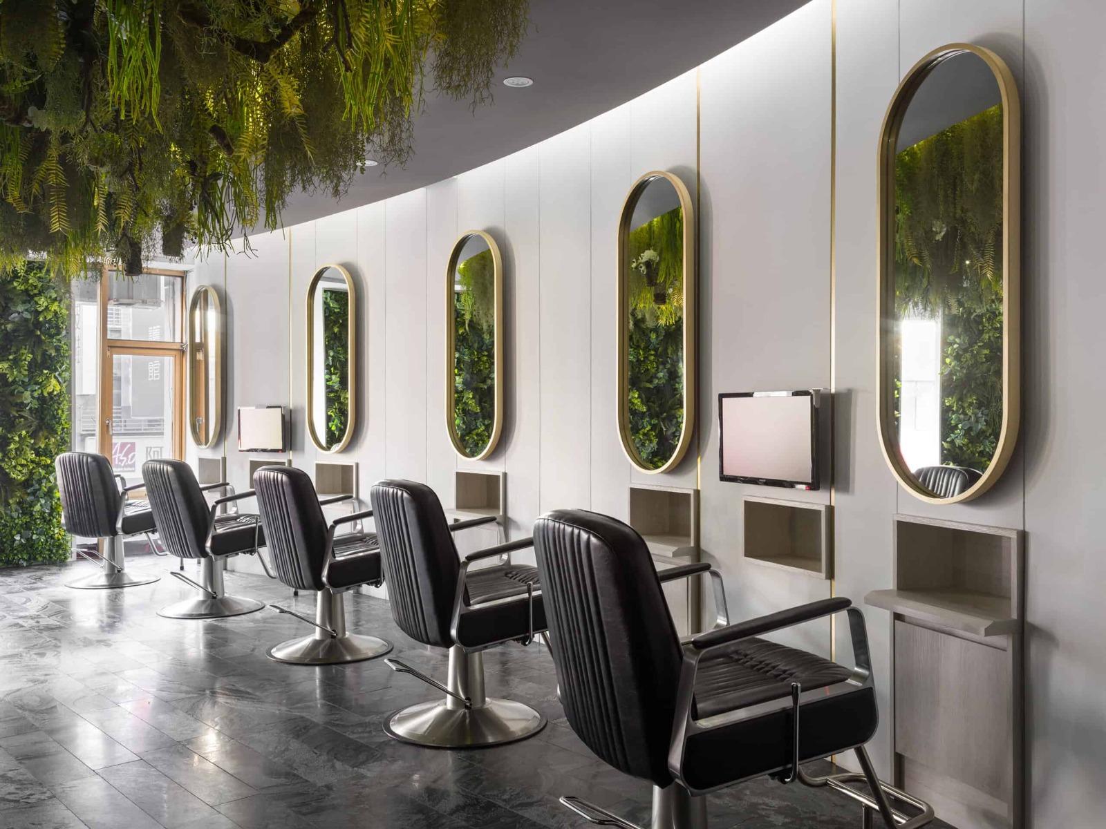 hair-stylist-stations-in-green-modern-salon-scaled.jpg